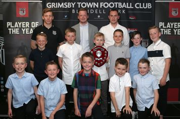 Grimsby Town U10 squad, with Player of the Year Brian Mudlaff-Minda in the centre