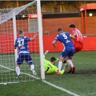 Controversial penalty denies Reds three points