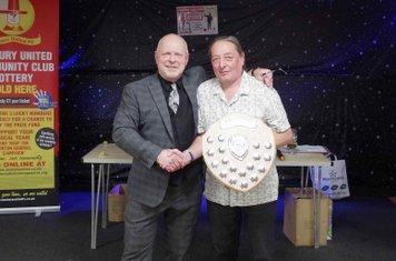 Brian Baker receives the Star UK Travel Appreciation Award from Ricky Johnson on behalf of Stewart Green