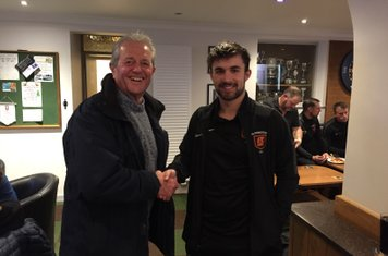 Bailey Jason Ryan receiving his Player of the Month award from Committee Member Mike Warren