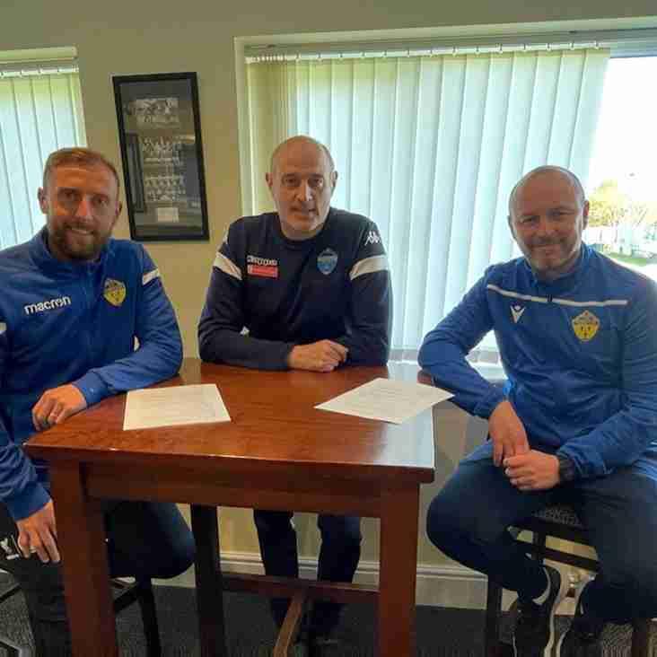 Warrington Town management team sign new deals