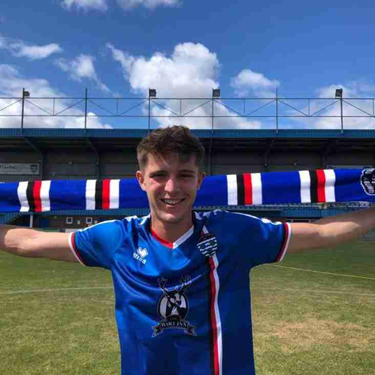 Whitby Town sign Fergus and Griffiths