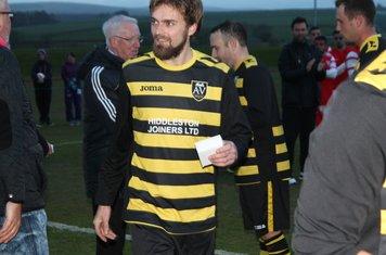 Goalscorer baxter collects his medal