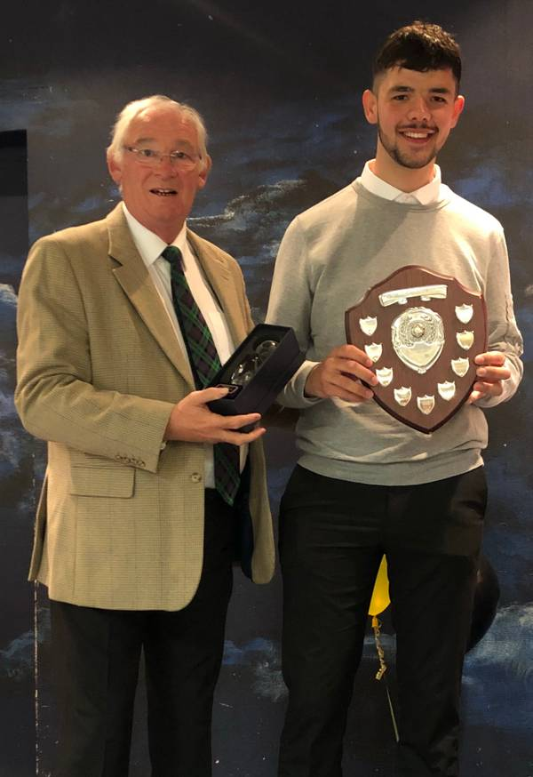 Jim Leishman presents the Supporter's POTY to T Goss