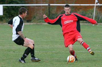 Simon Bolland takes on the defender