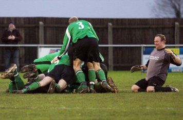 - and he is swamped by his team mates!!!!!!