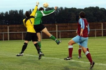 Ryan Oliver challenges the keeper