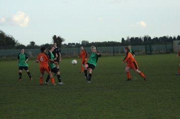 Jenny Withers flicks the ball forward