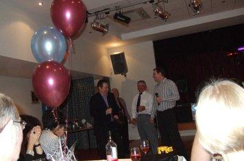 TC claming his tie for his century against Miskin in 2008