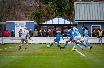Ollie Hughes shoots for goal against Brentwood Town