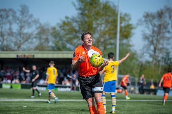 Ollie Hughes celebrates a Bury goal