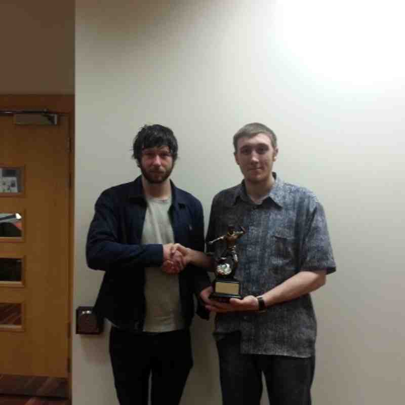 Michael Romilly (Newport) receiving the Lindsay Bell First Division Player Of The Year Trophy from Graham Bell son of the late Lindsay Bell.