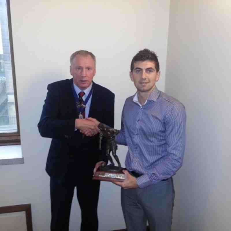 Daryl McKenzie (Dundee City) receiving the Trident Trophies Division Two Player Of The Year trophy from MAFA President Gordon Farmer.