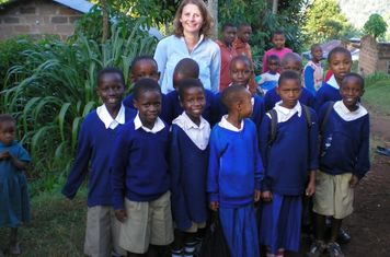 Kath with children in Tanzania
