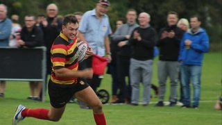 Dinbych secure Division 1 status with 4 try victory