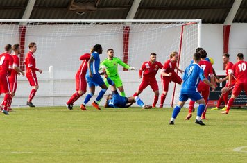 Whitstable clear the ball following a corner