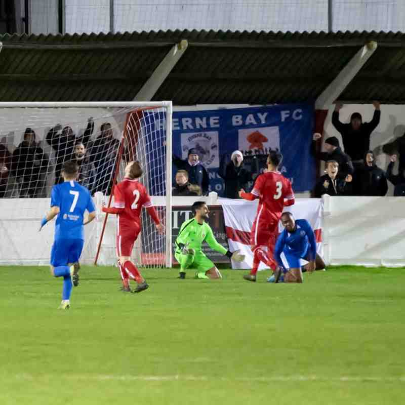 Jez Hammond slides the ball into his own net to add a second for Herne Bay