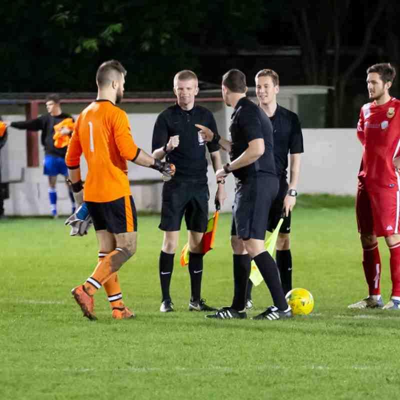 Former Whitstable goalkeeper Luke Watkins represents Faversham at the pre-match briefing