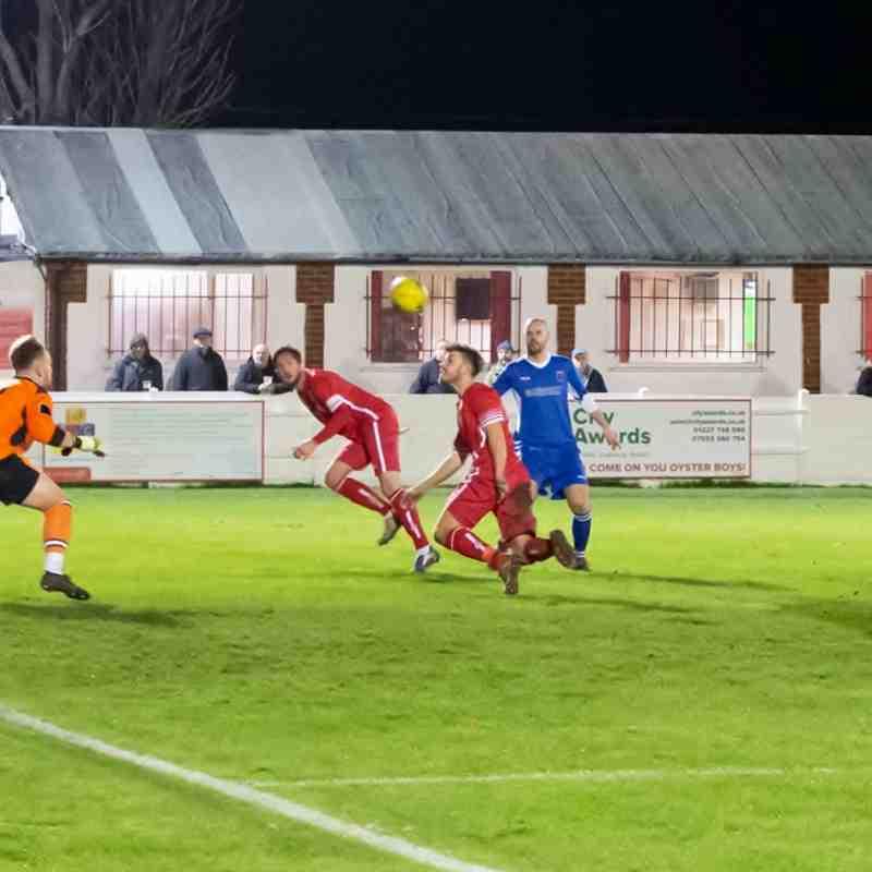 Aaron Millbank heads the ball towards goal