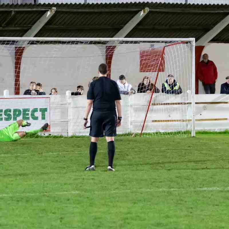 Dan Eason saves from Tom Loynes in the penalty shootout