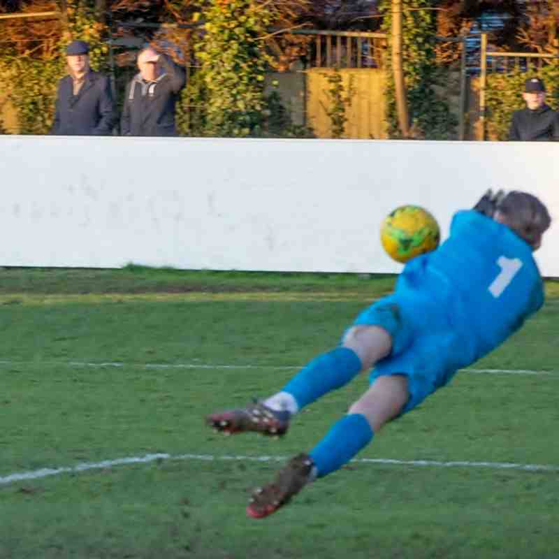 Charlie Burns turns the ball behind for a corner