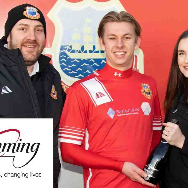 Alex Godden presents the man of the match award sponsored by Slimming World to Harry Stannard