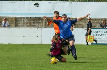 Its a penalty as Callum Ball is brought down