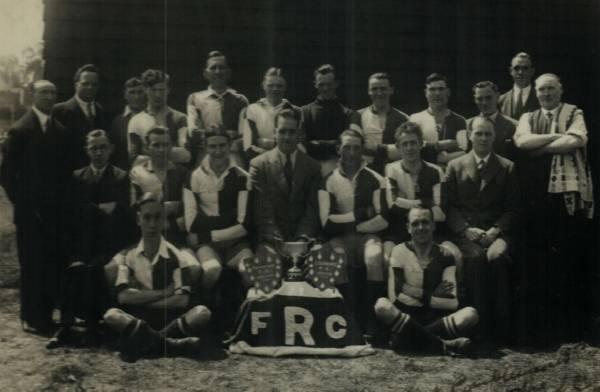 "1933-34(Reserve team) T.W.Lee, Alf Kinch, E.Hayes, J.W.Malton,F. Rowell, Ronnie Rook,R. Evans, Joe Hambridge, ? , C.Sands,  Freeman. seated; George Moon, A.Croucher, J. Honeybun, Jimmy Hanger, Jim Jackson, Sid Seear, Dr Simpson, A.""Pimp"" Moon, R. Hutchins"