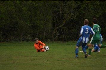 George Slatters shot is saved by the Yarnton keeper