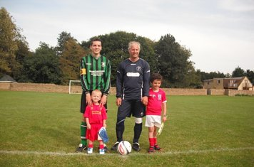 Captains Kevin Mulhearn and Paul Catling before the game with the mascots