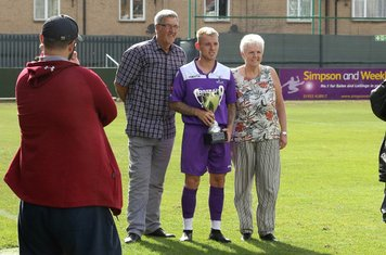 Ryan Blackman accepts the Dale Roberts Memorial Cup from George and Isabel  Roberts, Dale's parents.
