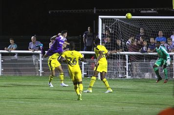 Brandon Adams heads the ball for Town