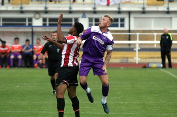 Ryan Blackman goes up for the ball