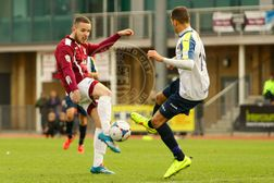 Hooper Strikes in Controversial Match