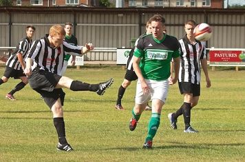 Defender clears from Luke Crosby
