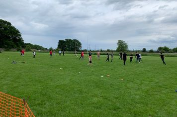 Kids having a game of touch rugby