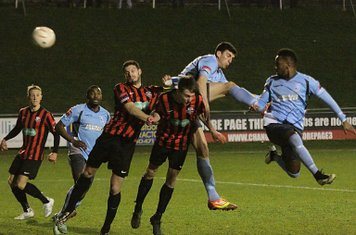 Enfield's Bobby Devyne (R) and Claudiu Vilcu challenge at a corner
