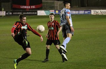 Chris Breach (L) of Lewes clears from Corey Whitely