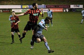 Lewes captain Gary Elphick wins a challenge against Joe Stevens