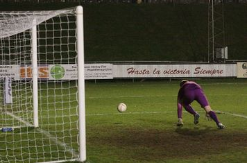Lewes keeper Rikki Banks fumbles a shot but wide of the post