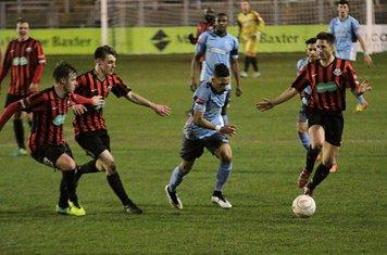 Enfield's Corey Whitely tries to run through the defence