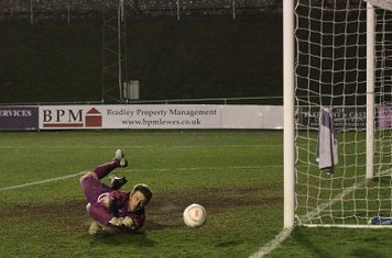 Lewes keeper Rikki Banks tips a shot round the post