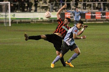 Lewes captain Gary Elphick (red/black) challenges Corey Whitely