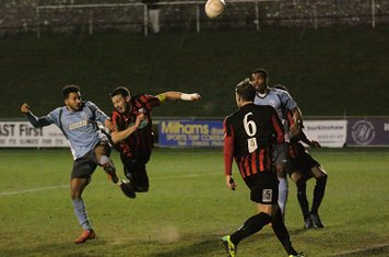 Enfield's Tyler Campbell (L) wins a header despite the challenge of Gary Elphick
