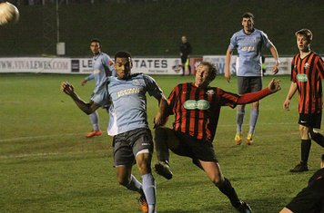 Chris Breach (R) of Lewes clears from Michael Kalu