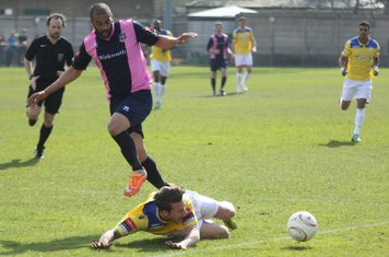 Joe Stevens (yellow) appeals unsuccessfully for a penalty after a challenge from Ashley Carew