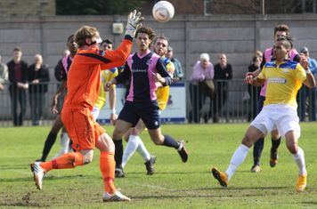 Dulwich keeper Phil Wilson collects the ball ahead of Corey Whitely
