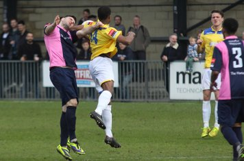 Dulwich's Jack Dixon (L) and Enfield's Dernell Wynter