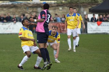 Dulwich's Frazer Shaw (3) heads clear from Dernell Wynter (L) and Jordan Lockie