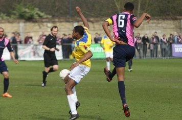 Dulwich's Ethan Pinnock (6) clears from Dernell Wynter